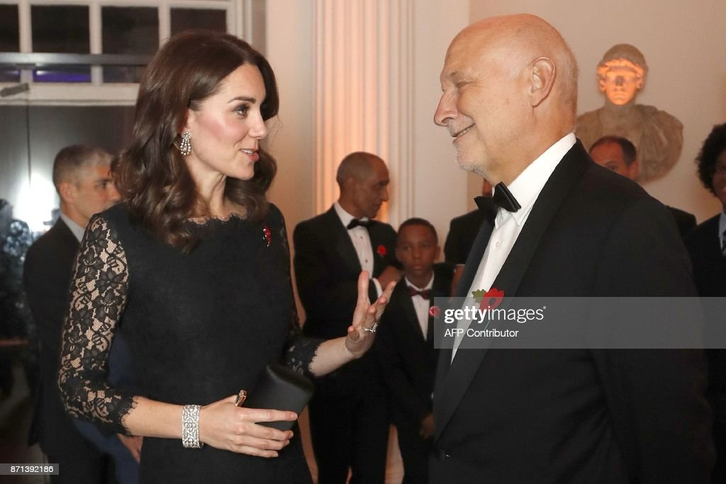 Britain's Catherine, Duchess of Cambridge speaks to Peter Fonagy, CEO of the Anna Freud Center at the 2017 Gala Dinner for The Anna Freud National Centre for Children and Families (AFNCCF), at Kensington Palace in London on November 7, 2017. During the Gala, The Duchess will attend a reception to hear more about this project and the work of the AFNCCF from those who are closely involved in the Charity. She will also meet with some of the charitys service users, including families who have benefitted from the work of the organisation. / AFP PHOTO / POOL / Frank Augstein