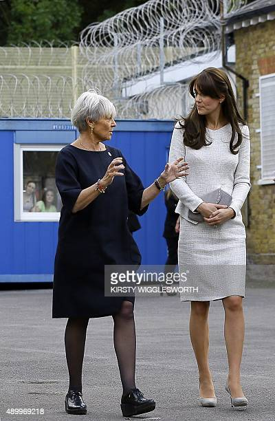 Britain's Catherine Duchess of Cambridge speaks with Benita Refson from the Rehabilitation of Addicted Prisoners Trust during a visit to the women's...