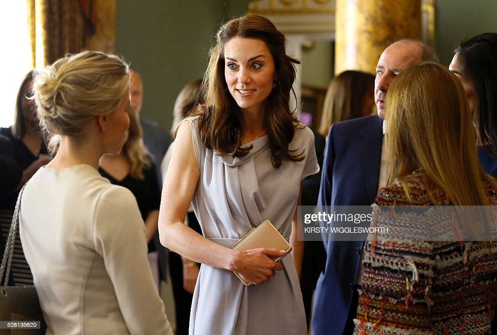 Britain's Catherine, Duchess of Cambridge (C) speaks with guests during a reception at Spencer House in London on May 4, 2016. The Duchess of Cambridge undertook her first engagement as Patron of the Anna Freud Centre by attending a lunch reception supporting the development of a new centre of excellence for children's mental health. / AFP / POOL / Kirsty Wigglesworth