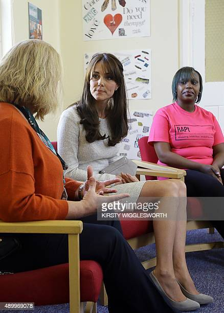 Britain's Catherine Duchess of Cambridge speaks with Isha Walker who is on the Rehabilitation of Addicted Prisoners Trust programme and unit manager...