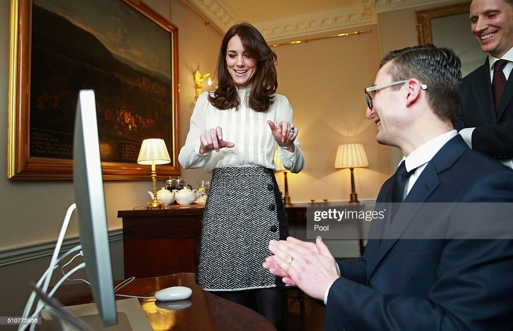 Britain's Catherine, Duchess of Cambridge, (L) speaks with James Martin, Executive Editor of Huffington Post UK, (C) and Stephen Hull, (R) Editor-in-Chief of Huffington Post UK, as she guest-edits the British edition of news website The Huffington Post at Kensington Palace in London, on February 17, 2016. The mother-of-two launched a new global initiative, 'Young Minds Matter', as she took over the site, writing: 'For too long we have been embarrassed to admit when our children need emotional or psychiatric help.' / AFP / Chris Jackson