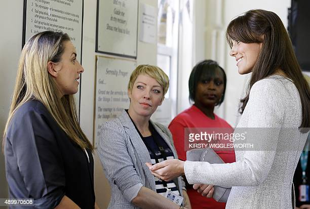 Britain's Catherine Duchess of Cambridge speaks with Kirsty Tate and Kirsty Lacey graduates of the Rehabilitation of Addicted Prisoners Trust...