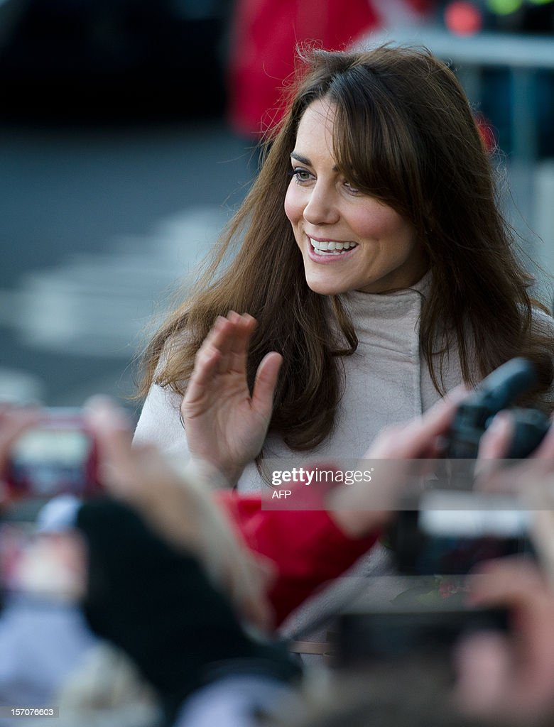 Britain's Catherine, Duchess of Cambridge speaks with members of the public as she and Britain's Prince William, Duke of Cambridge arrive for a visit to Peterborough City Hospital in Peterborough, Cambridgeshire, north of London, on November 28, 2012. Britain's Prince William and his wife Catherine visited the university city that is home to their dukedom on November 28 for the first time since they were given their official titles.