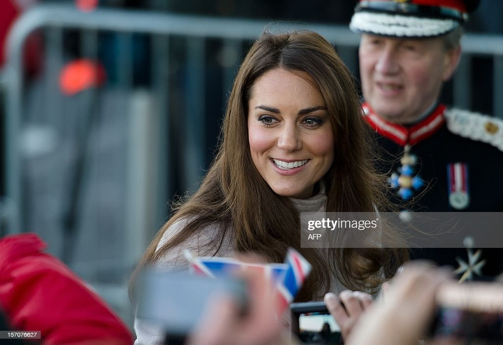 Britain's Catherine, Duchess of Cambridge speaks with members of the public as she and Britain's Prince William, Duke of Cambridge arrive for a visit to Peterborough City Hospital in Peterborough, Cambridgeshire, north of London, on November 28, 2012. Britain's Prince William and his wife Catherine visited the university city that is home to their dukedom on November 28 for the first time since they were given their official titles. AFP PHOTO / LEON NEAL