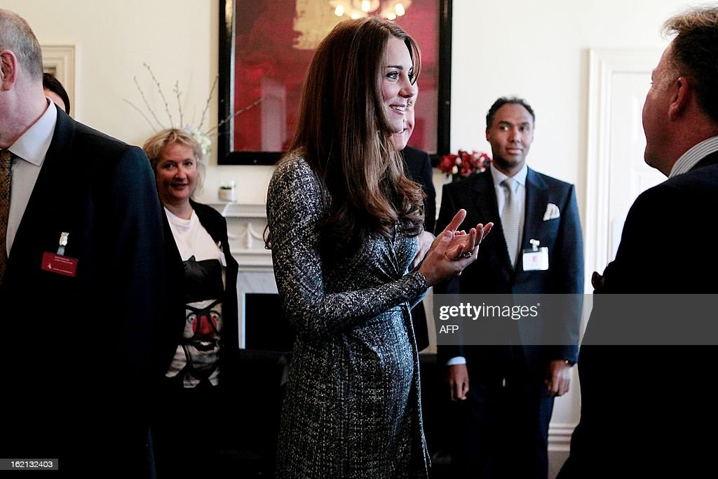 Britain's Catherine, Duchess of Cambridge (C) speaks with trustees at Hope House charity in south London on February 19, 2013. The Duchess visited Hope House, an all-female rehabilitation centre which is is one of the projects run by her patronage, Action on Addiction.