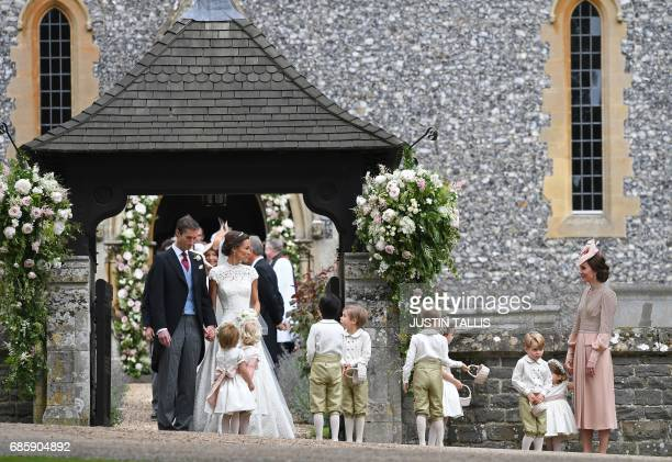 Britain's Catherine Duchess of Cambridge stands with her children Britain's prince George and Britain's princess Charlotte following the wedding of...