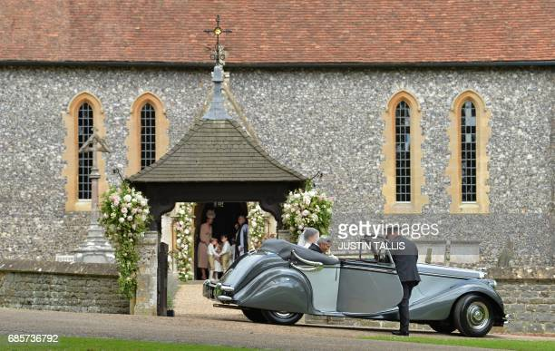 Britain's Catherine Duchess of Cambridge stands with pageboys and bridesmaids in the doorway of St Mark's Church in Englefield west of London on May...