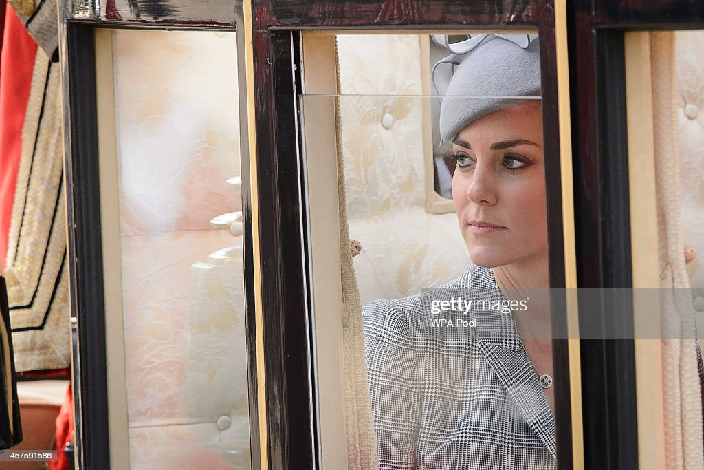 Britain's Catherine, Duchess of Cambridge, takes her seat a State Carriage for the carriage procession to Buckingham Palace as part of the ceremonial welcome ceremony for Singapore's President Tony Tan Keng Yam at the start of a state visit at Horse Guards Parade on October 21, 2014 in London, England. The President is at the beginning of his four day stay during which he will hold a bilateral meeting with Prime Minister David Cameron.