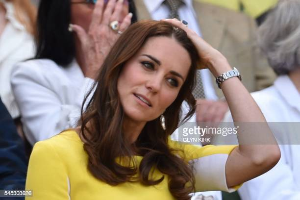 Britain's Catherine Duchess of Cambridge takes her seat in the royal box on centre court to watch the women's semifinal match between US player...