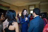 Britain's Catherine Duchess of Cambridge talks to guests at a reception at Kensington Palace London on the April 6 2016 ahead of their tour of India...