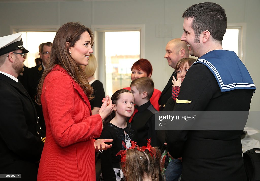 Britain's Catherine, Duchess of Cambridge (L) talks with Artful crew members and their families during a visit to the Astute-class Submarine Building at BAE Systems in Barrow-in-Furness, Cumbria, northern England, on April 5, 2013. The Duke of Cambridge is Commodore-in-Chief of the Royal Navy Submarine Service and during their visit they toured the offices of Vanguard replacement programme and meet with the crew of Artful and their families, who are now based in Barrow.