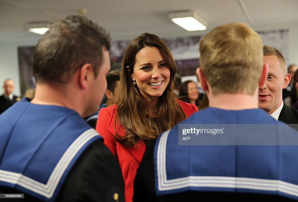 Britain's Catherine, Duchess of Cambridge talks with crew members as she visits the Astute-class Submarine Building at BAE Systems in Barrow-in-Furness, Cumbria, northern England, on April 5, 2013. The Duke of Cambridge is Commodore-in-Chief of the Royal Navy Submarine Service and during their visit they toured the offices of Vanguard replacement programme and meet with the crew of Artful and their families, who are now based in Barrow. AFP PHOTO / POOL / CHRIS JACKSON