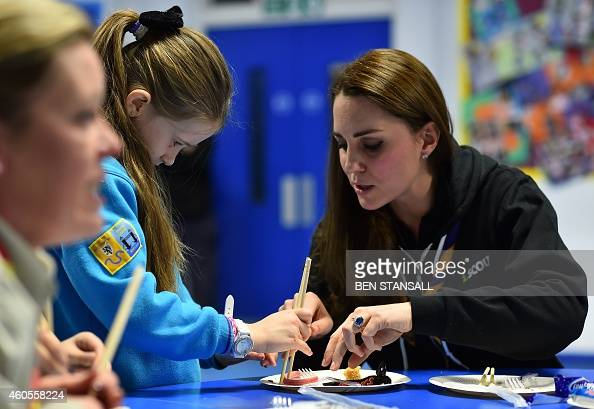 Britain's Catherine, Duchess of Cambridge teaches a girl