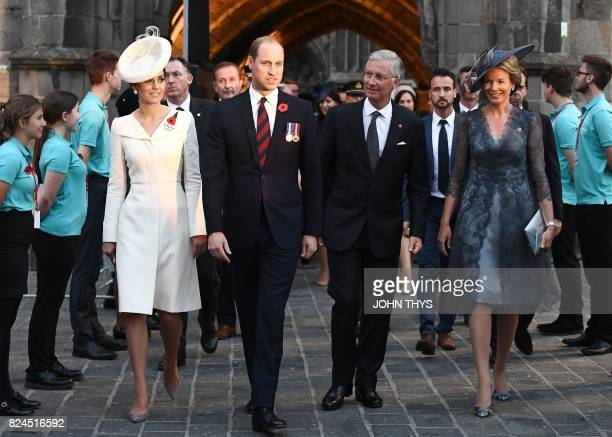 TOPSHOT Britain's Catherine Duchess of Cambridge the wife of Britain's Prince William Duke of Cambridge walk along side King Philippe of Belgium and...