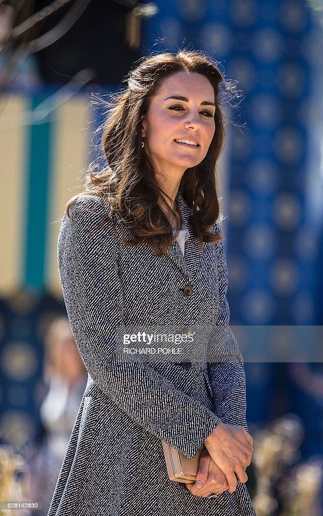 Britain's Catherine, Duchess of Cambridge, tours the newly opened 'Magic Garden' children's play area at Hampton Court Palace in south-west London on May 4, 2016. The Duchess's visit marked the official opening garden, which was designed by architect Robert Myers, and is said to draw inspiriation myts and legends of the Tudor Court. / AFP / POOL / RICHARD