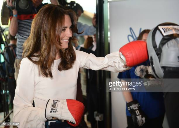 TOPSHOT Britain's Catherine Duchess of Cambridge tries out boxing at the launch of the Heads Together campaign on mental health at the Olympic park...