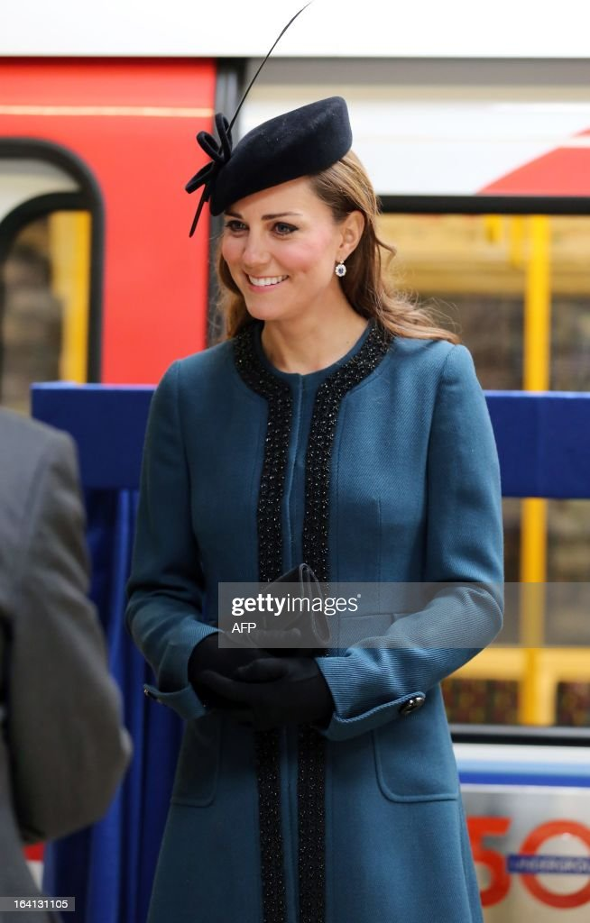 Britain's Catherine, Duchess of Cambridge, visits Baker Street tube station with Queen Elizabeth II and Prince Philip, Duke of Edinburgh, in London on March 20, 2013 to mark 150th anniversary of the London underground. The 86-year-old queen attended her first public engagement for more than a week after she had to cancel a number of events last week as she was still recovering from a bout of gastroenteritis which saw her admitted to hospital on March 3 for the first time in ten years.