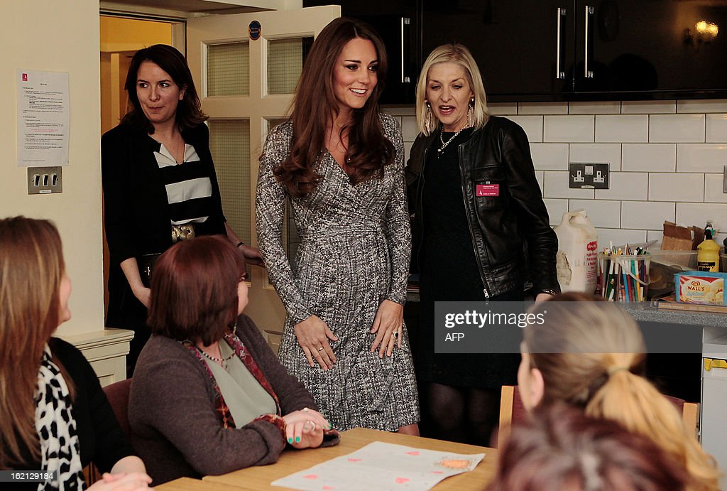 Britain's Catherine, Duchess of Cambridge (C) visits the art therapy group at Hope House charity in south London on February 19, 2013. The Duchess visited Hope House, an all-female rehabilitation centre which is is one of the projects run by her patronage, Action on Addiction.