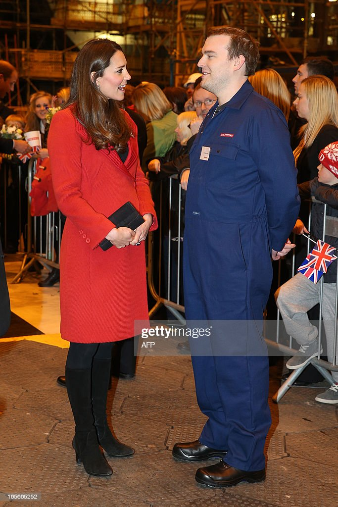 Britain's Catherine, Duchess of Cambridge (L) visits the Astute-class Submarine Building at BAE Systems in Barrow-in-Furness, Cumbria, northern England, on April 5, 2013. The Duke of Cambridge is Commodore-in-Chief of the Royal Navy Submarine Service and during their visit they toured the offices of Vanguard replacement programme and meet with the crew of Artful and their families, who are now based in Barrow.