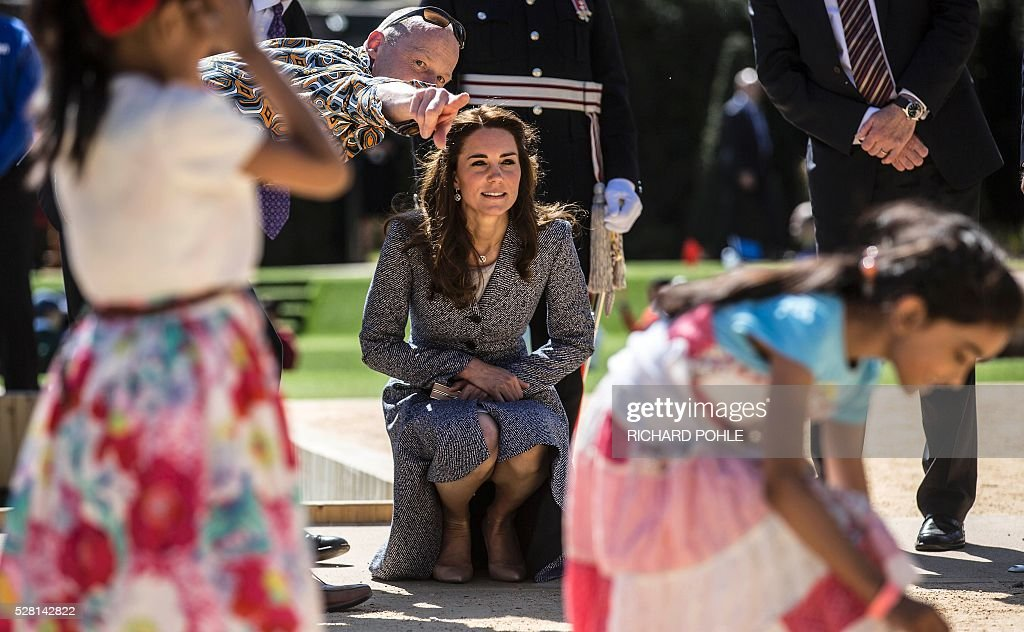 Britain's Catherine, Duchess of Cambridge, visits the newly opened 'Magic Garden' children's play area at Hampton Court Palace in south-west London on May 4, 2016. The Duchess's visit marked the official opening garden, which was designed by architect Robert Myers, and is said to draw inspiriation myts and legends of the Tudor Court. / AFP / POOL / RICHARD