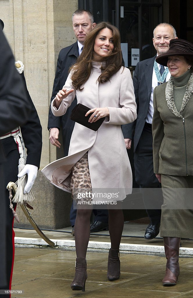 Britain's Catherine, Duchess of Cambridge walks with local dignatories during her visit to Cambridge, north of London, on November 28, 2012. Britain's Prince William and his wife Catherine visited the university city that is home to their dukedom on November 28 for the first time since they were given their official titles.