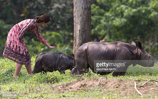Britain's Catherine Duchess of Cambridge walks with rhino calfs at the Centre for Wildlife Rehabilitation and Conservation at Panbari reserve forest...