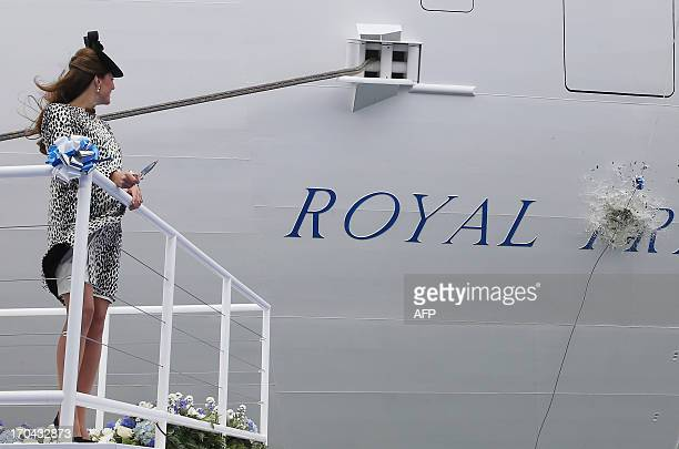 Britain's Catherine Duchess of Cambridge watches as a bottle of champagne smashes on the hull to officially name Princess Cruises's new ship 'Royal...