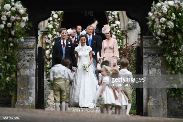 Britain's Catherine Duchess of Cambridge watches as her sister Pippa Middleton walks with her new husband James Matthews following their wedding at...