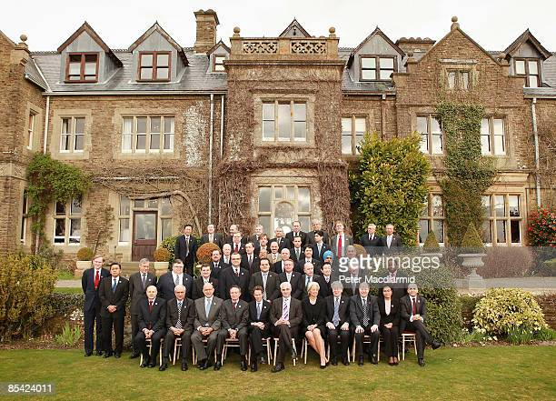 Britain's Chancellor of the Exchequer Alistair Darling sits for a group photograph with fellow finance ministers and central bank governors during...