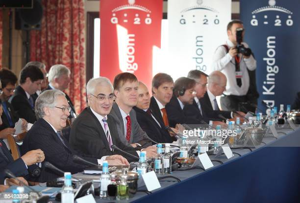 Britain's Chancellor of the Exchequer Alistair Darling sits with Financial Secretary to the Treasury Stephen Timms and Mervyn King Governor of the...