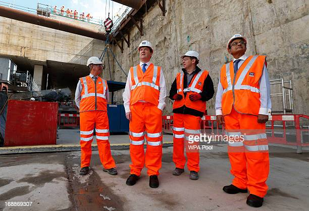 Britain's Chancellor of the Exchequer George Osborne accompanied by India's Finance Minister Palaniappan Chidambaram tour the Pudding Mill Lane...