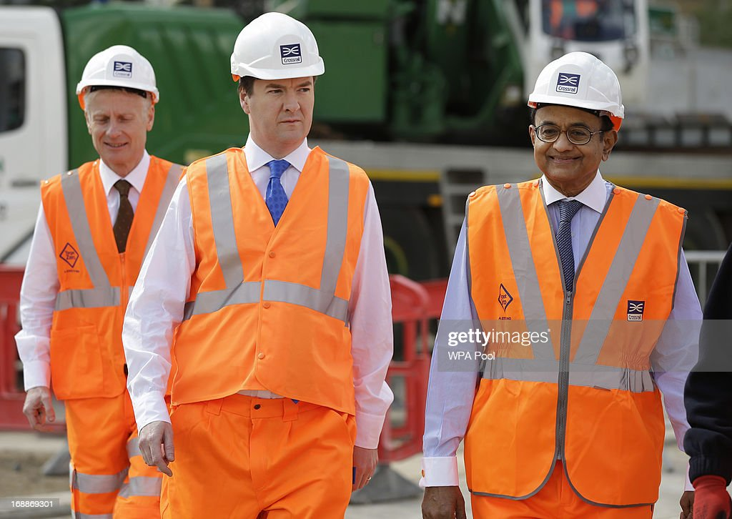 Britain's Chancellor of the Exchequer George Osborne left accompanied by India's Finance Minister Palaniappan Chidambaram tour the Pudding Mill Lane...