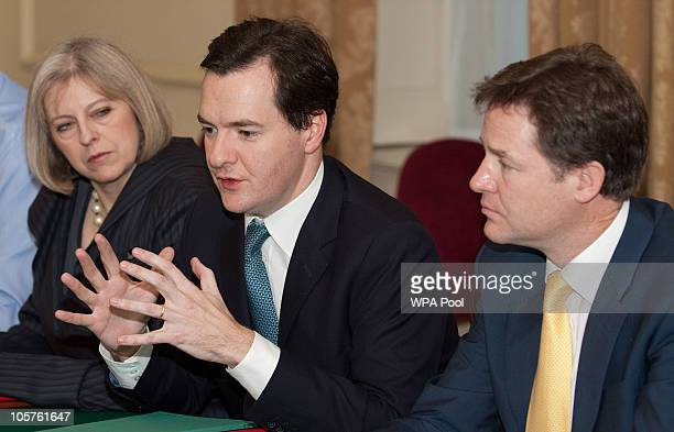 Britain's Chancellor of the Exchequer George Osborne speaks as Deputy Prime Minister Nick Clegg and Home Secretary Theresa May look on during a...
