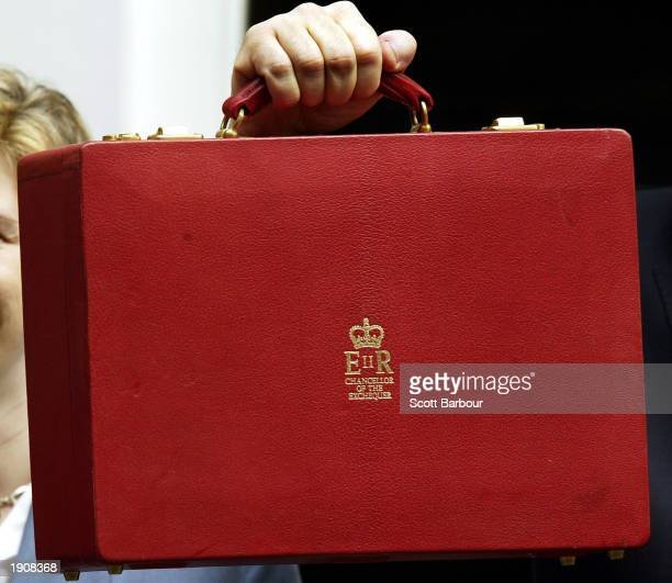 Britain's Chancellor of the Exchequer Gordon Brown holds his briefcase which contains the budget April 9 2003 in London England