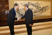 Britain's Chancellor of the Exchequer Philip Hammond and Chinese Vice Premier Ma Kai shake hands during their meeting at Zhongnanhai Leadership...