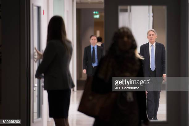 Britain's Chancellor of the Exchequer Philip Hammond arrives to tour the IBM office in London on July 26 as the preliminary estimates for 2017 Q2 GDP...