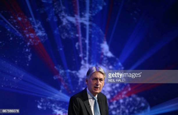 Britain's Chancellor of the Exchequer Philip Hammond delivers a speech at the International Fintech Conference in London on April 12 2017 / AFP PHOTO...