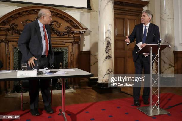 Britain's Chancellor of the Exchequer Philip Hammond introduces the SecretaryGeneral of the Organisation for Economic Cooperation and Development...
