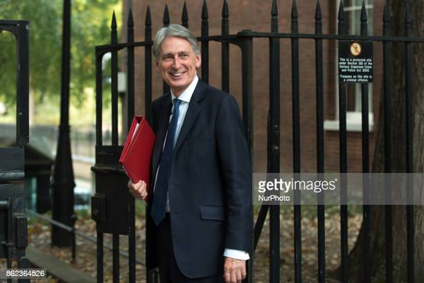 Britain's Chancellor of the Exchequer Philip Hammond leaves after attending a Cabinet meeting in Downing Street London on October 17 2017