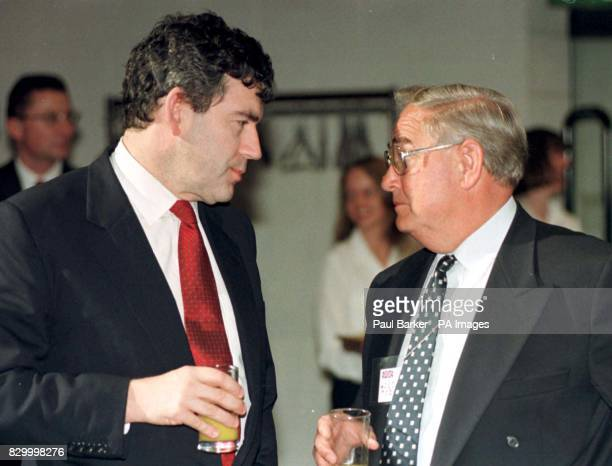 Britains Chancelor Gordon Brown and Eddie George Govenor of the Bank of England come face to face at tonights reception at the National Railway...