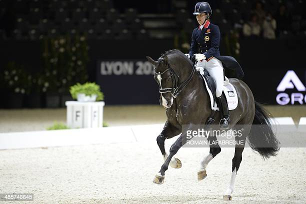 Britain's Charlotte Dujardin competes on her horse Valegro during the Reem Acra FEI World Cup dressage final at the Eurexpo Hall in Chassieu near...
