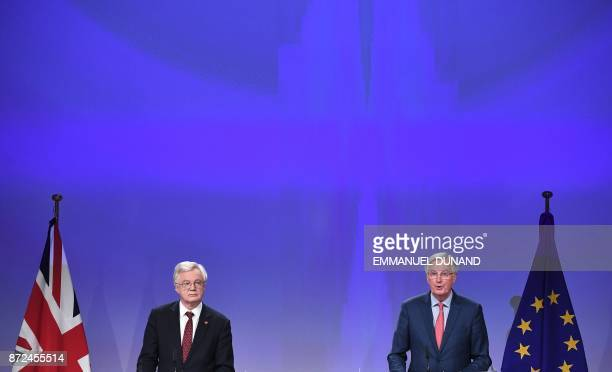 Britain's chief Brexit negotiator David Davis and EU's chief Brexit negotiator Michel Barnier address the media after a sixth round of Brexit talks...