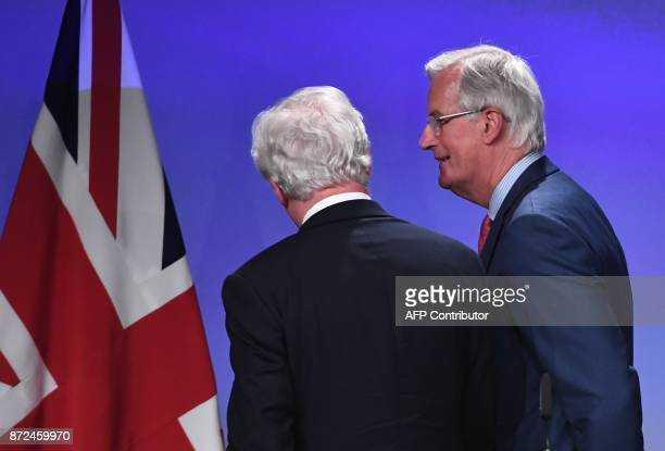Britain's chief Brexit negotiator David Davis and EU's chief Brexit negotiator Michel Barnier leave after addressing the media following a sixth...