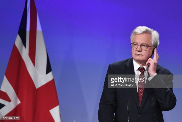 Britain's chief Brexit negotiator David Davis listens to a translation as he addresses the media with his EU counterpart following a sixth round of...