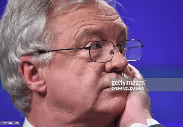 Britain's chief Brexit negotiator David Davis listens to his EU counterpart addressing the media following a sixth round of Brexit talks at the...