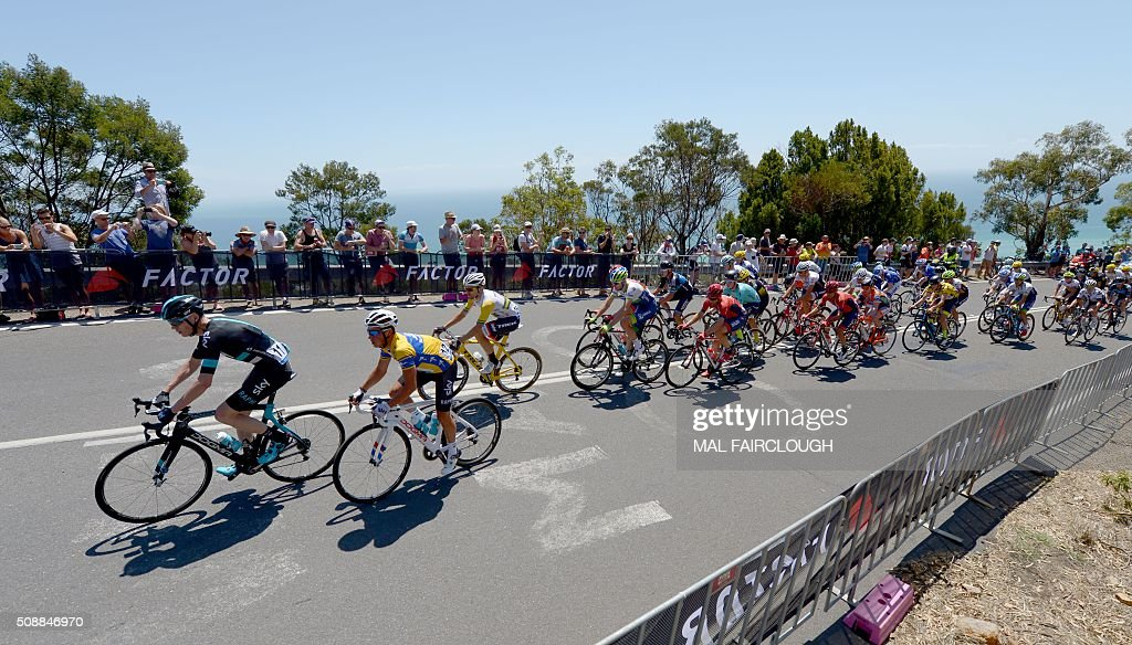Britains Chris Froome (L) leads Team Sky teammate Peter Kennaugh of Britain (2nd L) up Arthurs Seat during stage four of the 2016 Herald Sun Tour cycling race at Arthurs Seat in Victoria on February 7, 2016. AFP PHOTO / MAL FAIRCLOUGH FAIRCLOUGH