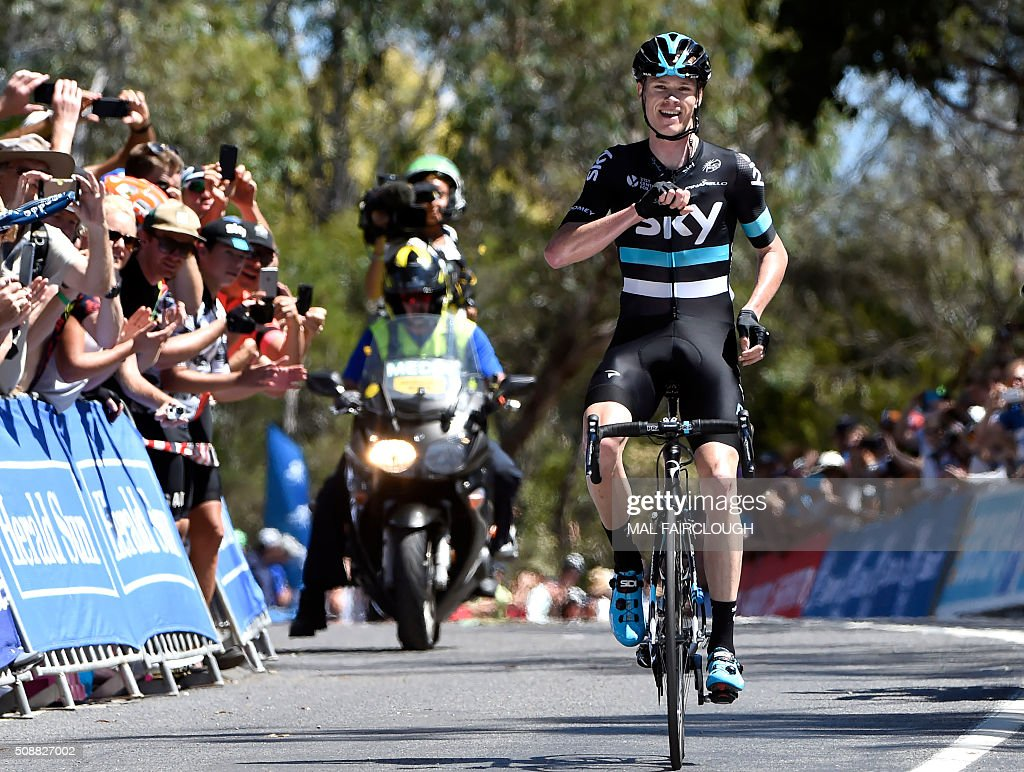 Britain's Chris Froome of Team Sky celebrates as he wins stage four of the 2016 Herald Sun Tour cycling race at Arthurs Seat to win the overall race in Victoria on February 7, 2016. AFP PHOTO / MAL FAIRCLOUGH FAIRCLOUGH