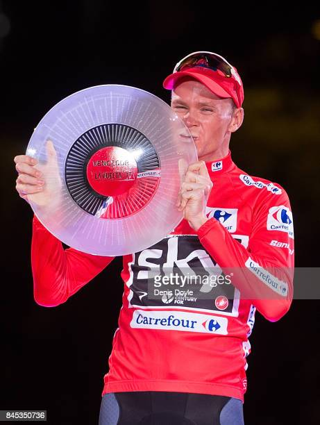 Britain's Chris Froome of Team Sky celebrates with his trophy on the podium after winning the Vuelta a Espana cycling race after the Stage 21 on...