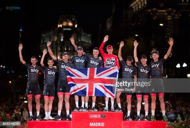 Britain's Chris Froome of Team Sky celebrates with teammates on the podium after winning the Vuelta a Espaa cycling race after the Stage 21 on...