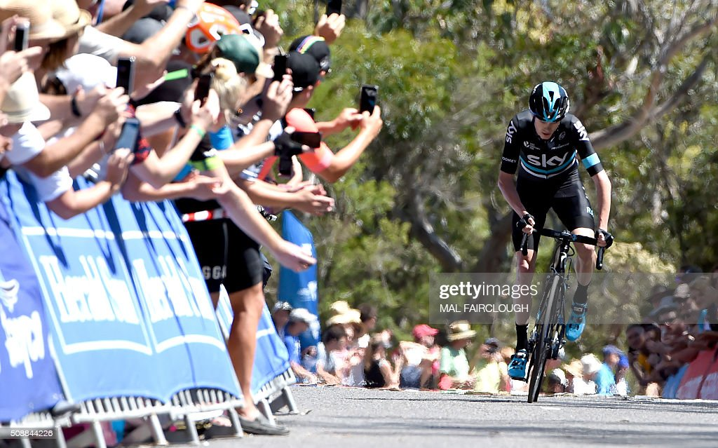 Britain's Chris Froome of Team Sky climbs past spectators during stage four of the 2016 Herald Sun Tour cycling race at Arthurs Seat in Victoria on February 7, 2016. AFP PHOTO / MAL FAIRCLOUGH FAIRCLOUGH
